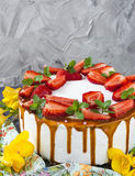 Cake with strawberry, mint and caramel. Cake with strawberry, mint, caramel and flowers Royalty Free Stock Image