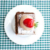 Cake with strawberry on plaid fabric Royalty Free Stock Image