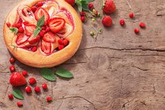 Cake with strawberry on wooden background stock photography