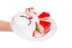 Cake in stukken wordt gesneden dat Royalty-vrije Stock Afbeelding