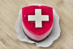 Cake with Suisse flag. royalty free stock image
