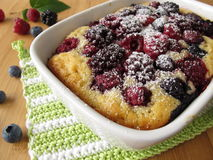 Cake with summer berries. And powdered sugar Stock Photo