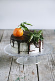 Cake with tangerine, cheese cream and chocolate glaze Royalty Free Stock Photo