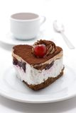 Cake and tea. Cake with cherry on the dish, and cup of tea Royalty Free Stock Image