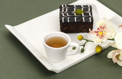 Cake and tea. Chocolate cake on the dish, cup of tea Stock Photo