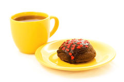 Cake and tea. Chocolate cake on the yellow plate and cup of tea royalty free stock photos