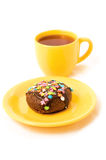 Cake and tea. Chocolate cake on the yellow plate and cup of tea stock photo