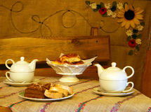 Cake and tea. Afternoon tea served with a cake and pastries Stock Image