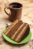 Cake with tea or coffee Stock Images