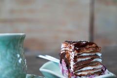 Cake and tea, Crepe cake with coffee Stock Photo