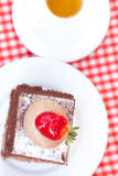 Cake and tea on plaid fabric Stock Photos
