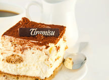Cake tiramisu and a cup of  coffee Stock Image