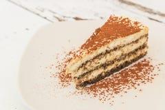 Cake. Tiramisu cake in white dish Royalty Free Stock Images