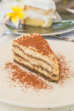 Cake. Tiramisu cake in white dish Stock Photos