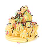 Cake topped with sprinkles. Royalty Free Stock Image