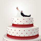 Cake topper. Gromm try to escape from wedding cake topper Royalty Free Stock Images
