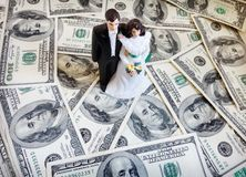 Cake topper couple. Bride and groom cake-topper couple on money stock photo