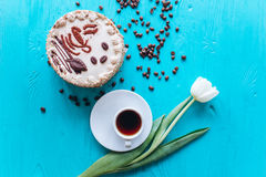 Cake, tulips and coffee on blue background Royalty Free Stock Photo