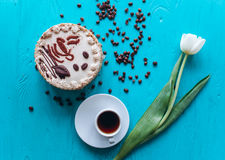 Cake, tulips and coffee on blue background Royalty Free Stock Photos