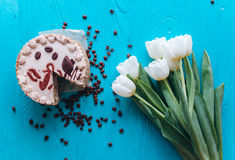 Cake, tulips and coffee on blue background Stock Photography