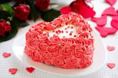 Cake for Valentine's Day with roses. Stock Photos