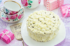 Cake with vanilla cream in the form of roses Royalty Free Stock Image