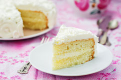 Cake with vanilla cream in the form of roses Royalty Free Stock Images