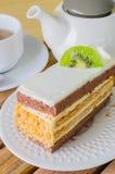 Cake. Vanilla cake with kiwi on white dish Stock Photos