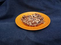 Cake walnut on the orange plate. Stock Photo