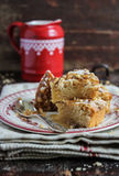 Cake with walnuts and maple syrup on a plate Royalty Free Stock Photo