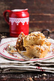 Cake with walnuts and maple syrup on a plate Stock Photography