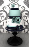 Cake. Wedding cake with blue flowers and background with luxury pattern wallpaper Royalty Free Stock Photography