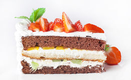 Cake with whipped cream and berries fruit Royalty Free Stock Photos