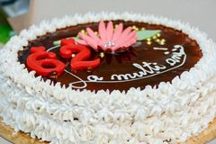 Cake. Whipped cream cake with chocolate saying happy birthday in Romanian Stock Photos