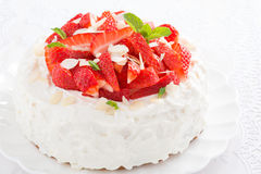 Cake with whipped cream and strawberries, close-up Royalty Free Stock Images
