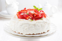 Cake with whipped cream and strawberries on a stand Royalty Free Stock Photos