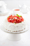 cake with whipped cream and strawberries on a stand, tea Royalty Free Stock Photo