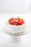 Cake with whipped cream and strawberries on a stand, vertical Stock Photos