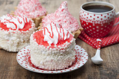 Cake with white air protein cream and red confectionery sprinkle Stock Photo
