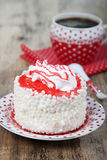 Cake with white air protein cream and red confectionery sprinkle Royalty Free Stock Images