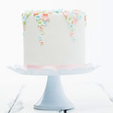 Cake. On white background with flowers on royalty free stock photography