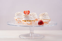 Cake with white cream and fresh strawberries on Royalty Free Stock Photography