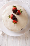 Cake with white icing and strawberries in chocolate closeup. ver Royalty Free Stock Image