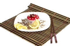 Cake white, with lemon segments, with grated chocolate, on a rug, the top view Royalty Free Stock Photo