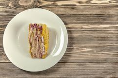 Cake on a white plate. Royalty Free Stock Image