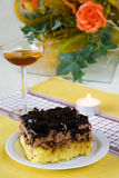 Cake and wine. Sweet cake and glass of wine in romantic atmosphere stock photography