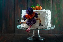 Cake with a witch and pumpkins Stock Image