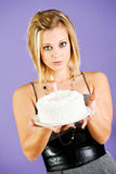 Cake: Woman Holds Out Cake With Single Candle Royalty Free Stock Photo