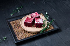 Cake in the wood dish lay on black wood table.  stock photos