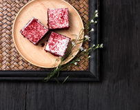 Cake in the wood dish lay on black wood table. Cake in the wood dish lay on wood table royalty free stock photography